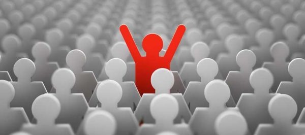The symbol of a leader in the form of a red man with his hands up in a crowd of white men. 3d render